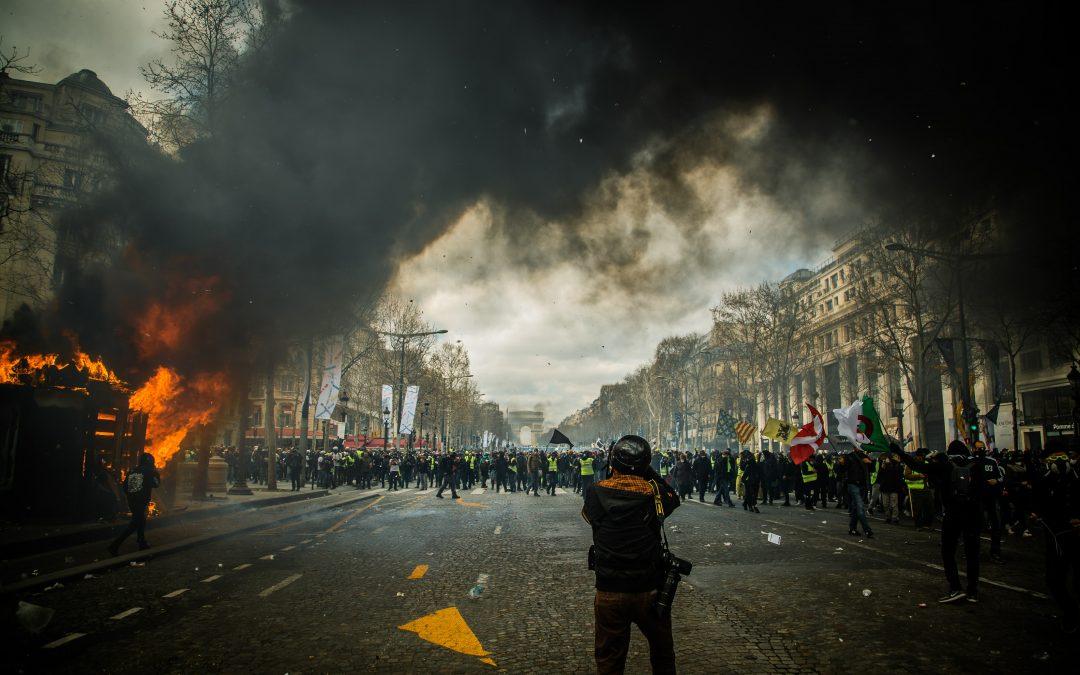 Wall street parties, main street burns